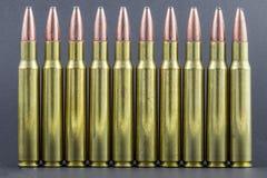 A row of ammo. A row of rifle ammo Stock Photo