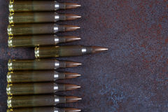 A row of ammunition. Concept of the first shot. On a rusted metal background Royalty Free Stock Photo