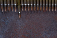 A row of ammunition. Concept of the first shot. On a rusted metal background Stock Photo