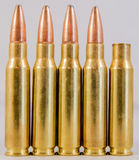 Row of ammunition with a fired round Royalty Free Stock Image