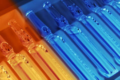 Row of ampules in UV and red gradient Stock Photos