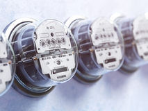 Row of analog electric meters. Electricity consumption concept. Royalty Free Stock Image