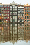 Row of ancient Amsterdam canal houses in the afternoon Royalty Free Stock Photography