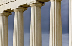 Row of ancient Greek pillars. Of doric rhythm Stock Images