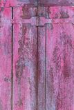 Row of ancient pink weathered window shutters background Royalty Free Stock Photo