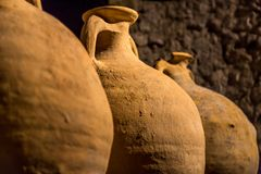A Row of Ancient Roman Vats - Jugs. Ancient Roman Vats used to store wine and water in roman times, Rome, Italy Royalty Free Stock Photography