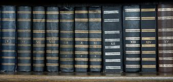 Row of Antique Books in Library stock image