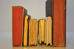 Row antique books. With red and gold slices Royalty Free Stock Image