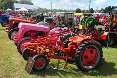 A row of antique farming tractors. Royalty Free Stock Photos