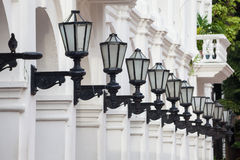 Row of antique street laterns. One bird and a row of antique street laterns in Cartagena de Indias Stock Photography