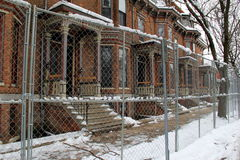 Row of apartment buildings being renovated,chain-link fencing outside Royalty Free Stock Images