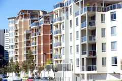 A row of apartments. Showing the closeness of suburban city life. Copyspace Stock Images