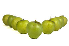 Row of apples. Forming letter V Stock Photography