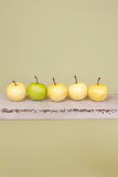 Row of Apples on Rustic Wood Bench Royalty Free Stock Photo