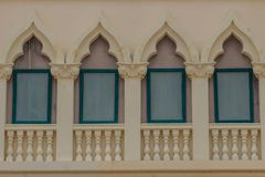 Row of arch windows on the balcony with stucco wall background. Row of arch windows on the balcony with stucco wall background of architecture Stock Photography