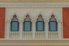 Row of arch windows on the balcony with stucco wall background. Row of arch windows on the balcony with stucco wall background of architecture Stock Photos