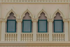 Row of arch windows on the balcony with stucco wall background. Row of arch windows on the balcony with stucco wall background of art Royalty Free Stock Images