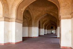 Row of Arches Receding toa Door Moghal Architecture. Symmetrical Arches of Typical Moghal style in a row present a geometrical design Stock Image