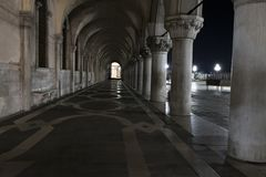 Row of arches underneath the Doge`s Palace in Piazza San Marco in Venice. Archway medieval columns in Venice. Row of arches underneath the Doge`s Palace in stock photos