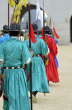 Row of armed guards in ancient traditional soldier uniforms in the old royal residence, Seoul, South Korea Royalty Free Stock Photos