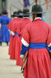 Row of armed guards in ancient traditional soldier uniforms in the old royal residence, Seoul, South Korea Stock Images