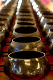 Row of arms bowl,Bowl carried by a Buddhist priest Royalty Free Stock Photography