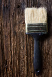 Row of artist paintbrushes close up on old natural rustic grunge Royalty Free Stock Photography