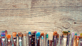 Row of artist paintbrushes closeup on old wooden rustic backgrou Stock Photography