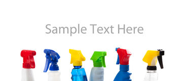 A row of assorted cleaning bottles with copy space Royalty Free Stock Images