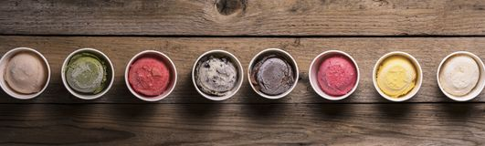 Row of assorted flavors and colors of gourmet Italian ice cream stock image