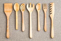 Row of assorted wooden kitchen utensils royalty free stock photos