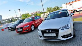 Row of Audi A3 Sportback on display at A3 Ttraktion Zone event Royalty Free Stock Photos