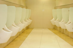 Row automatic urinals Royalty Free Stock Images