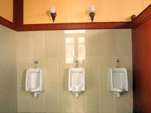 Row automatic urinals in the toilet. Row automatic urinals in a vintage toilet Royalty Free Stock Image