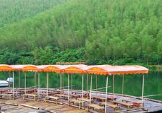 A row awnings near mountains and lake Stock Photography