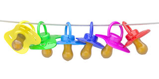 Row of babies dummies on rope. Royalty Free Stock Photography