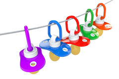 Row of babies pacifiers with rope Stock Image