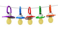 Row of babies pacifiers with rope Royalty Free Stock Photos