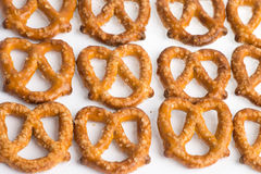 A row of baked pretzels on white. A row of baked pretzels on white royalty free stock photography