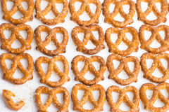 A row of baked pretzels on white. A row of baked pretzels on white royalty free stock photo
