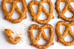 A row of baked pretzels on white. A row of baked pretzels on white stock image