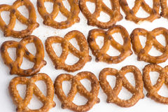 Row of baked pretzels on white. Row of baked pretzels on white stock images