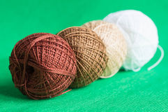 A row from balls of a multi-colored yarn Stock Images