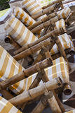 Row of bamboo chairs Stock Photos