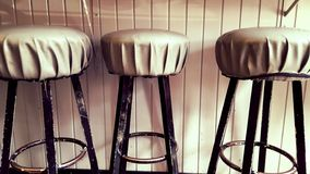 Row of bar chairs Stock Photo