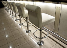 Row of bar stools Stock Photo