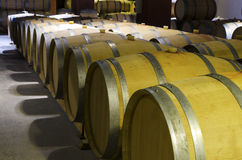 Row of barrels in a cellar in a Bulgarian winery. Selective focus Stock Photo