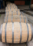 Row of Barrels Rolling Vertical Royalty Free Stock Photo