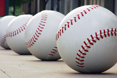Row of Baseballs Stock Photo