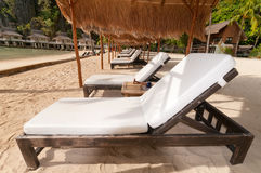 A row of beach beds at the shore Royalty Free Stock Photo